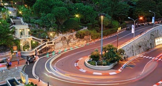 MONTE CARLO, MONACO - October 07, 2014: The Grand Hotel hairpin in Monte Carlo at night on October 07, 2014 in Monaco. Monte Carlo is host to the Formula One Monaco Grand Prix.