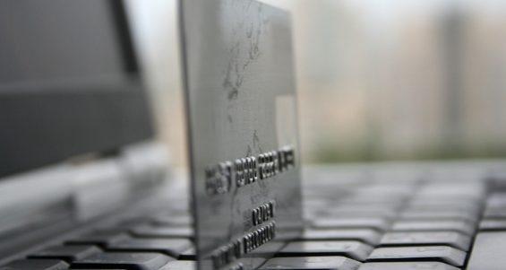 bigstock-A-Shot-Of-A-Laptop-And-A-Credi-2776735-1