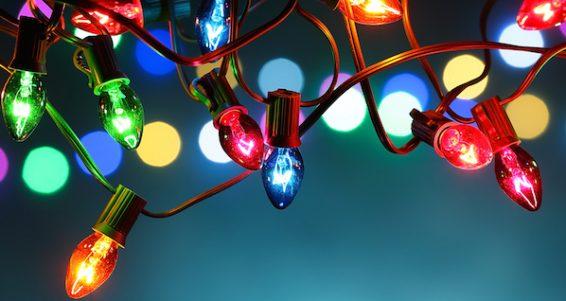 Christmas lights over dark blue background
