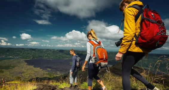 Group of hikers descending on friable ground in the caldera of volcano of Batur. Bali, Indonesia