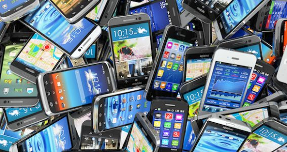 Mobile phones background. Pile of different modern smartphones. 3d