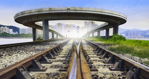 Railways Track And Bridge Cross Over With Urban Scene Behind Use For Land And Town Development And I