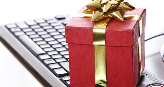 bigstock-Red-gift-box-on-computer-keybo-27365375