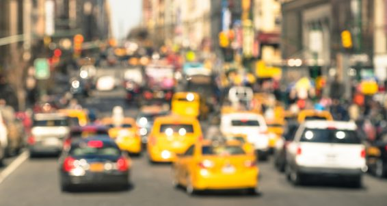 Rush Hour With Defocused Cars And Yellow Taxi Cabs - Blurred Traffic Jam In Manhattan Downtown