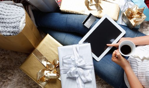 bigstock-Woman-Shopping-Online-With-A-C-106532585