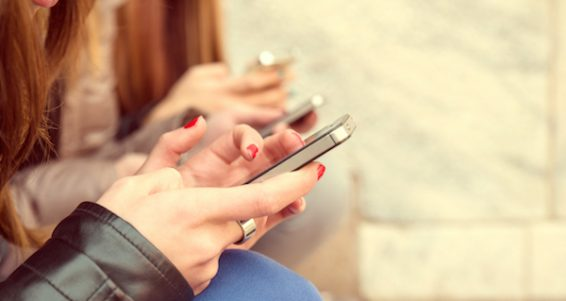 Women Typing On Mobile Phones