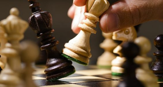 bigstock-playing-wooden-chess-pieces-36360949