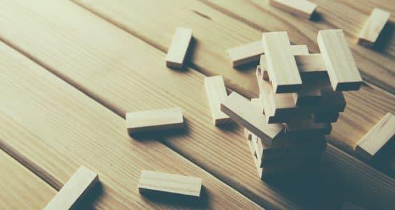 Jenga Wood blocks stack game on wood background