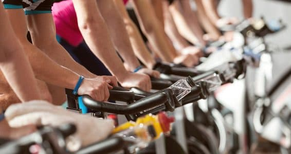 gym detail shot - people cycling; spinning class