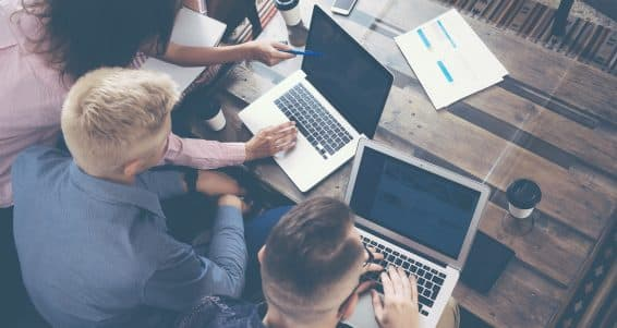 Group Young Coworkers Team Making Excellent Business Decisions.Creative People Discussion Corporate Work Concept Modern Office.New Startup Marketing Idea Presentation.Woman Touching Laptop.Top View