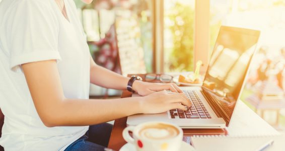Female working on laptop in a cafe. woman using laptop in home. using laptop internet. hand using laptop in coffe shop. Business entrepreneur asian girl working online on laptop in cafe. business entrepreneur asian using laptop in home.