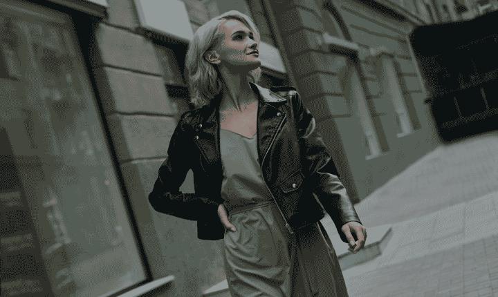 fashion model strolling city sidewalk