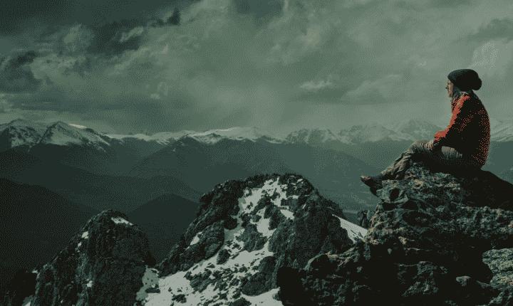 hiker overlooking mountain range