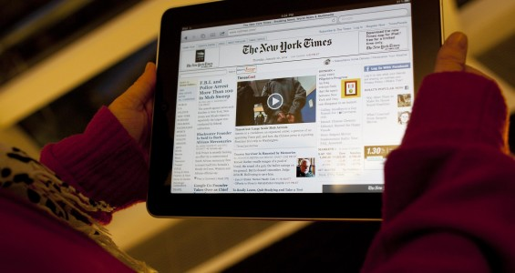 An Apple Inc. iPad tablet computer with the New York Times website displayed is held up for an illustration in New York, U.S., on Thursday, Jan. 20, 2011. New York Times Co. will charge readers less than $20 a month for full access to its namesake newspaper on the Web when the company introduces its paid service, a person familiar with the matter said. Photographer: Andrew Harrer/Bloomberg via Getty Images